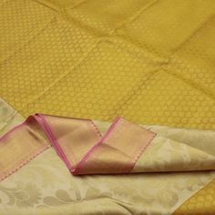 Reminiscent of the blazing sun, this half-and-half #Kanjivaram has a golden zari body with an elegant pattern of mangoes and buttas on one half; the other half is artfully woven in off-white body featuring blissful golden floral motifs. Meanwhile, the scene becomes serenely pink on the pallu; the broad border is again done gracefully in golden zari with rudraksha and leaf motifs...This enchanting Sarangi Kanjivaram #silk sari, a beautifully #handwoven masterpiece. Code 110124942.