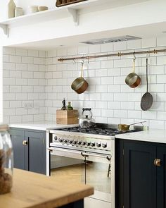 #repost @devolkitchens #welovenew A hanging rail can be a really great addition to any kitchen, but especially in those where there isn't necessarily much cupboard or storage space for bulky pans.
