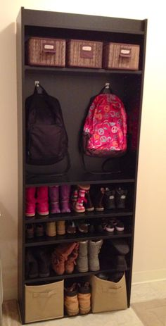 Bookcase turned into storage----something like this, but with lower hooks for bookbags, only 1 shelf for shoes and lots of room for me to put pictures :D