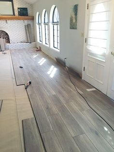Laminate flooring is a great option and saves on costs, it also comes in an array of stains to brighten up any room Yes, we do that too! #flooring #woodflooring #laminate #refinishedfloors #refinishedwood #DIY #houseupgrade #wood #stainedwood #stained
