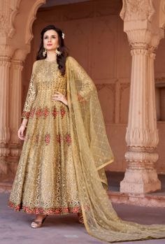 Radiant musturd embroidered anarkali suit online which is crafted from net fabric with exclusive embroidery and hand work. This stunning designer anarkali suit comes with and net dupatta and japan satin, american crepe inner. Long Choli Lehenga, Anarkali Gown, Anarkali Suits, Indian Anarkali, Punjabi Suits, Saris, Long Gown Dress, Dress Up, Costumes Anarkali