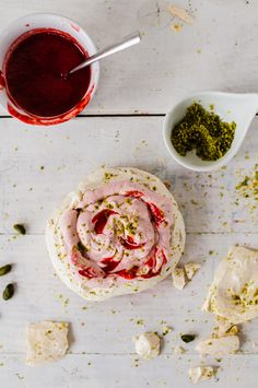 pistachio meringue pavlova with strawberry mascarpone cream and coulis