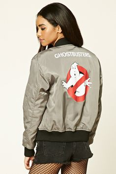 """A padded woven bomber jacket featuring a large """"Ghostbusters"""" graphic on the back, an embroidered logo patch on the front, a zipper front, long sleeves, front slit pockets, a zipper sleeve pocket, and a contrast ribbed trim."""
