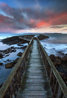 Footbridge to The Pans Rocks on The Strand Beach, Ballycastle just before sunrise, Ireland