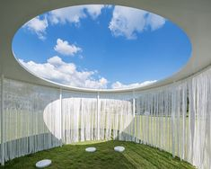 osted on the grounds of the amorepacific museum of art, south korea, OBBA architects explored fluid architecture that crosses the boundary of space within their pavilion. circular openings were cut from the roof, framing perfect circles of the sky above, meanwhile a curtain of white thread ran the length of the pavilion's perimeter. reminiscent of willow leaves, the curtain moved along with the breeze – blurring the boundary between the inside and outside