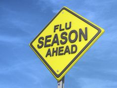 A yield road sign with Flu Season Ahead. Free art print of Flu Season Ahead Yield Sign.