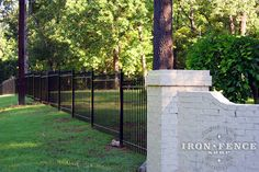 Wrought Iron Fence 'Stair Stepped' Down a Slope (4ft Tall Classic Style in Traditional Grade)