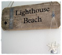 Lighthouse beach sign with hook.
