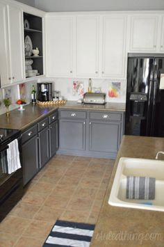 Easy kitchen redo: after painting kitchen cabinets, nickel hardware, painted tile backsplash, two toned cabinets