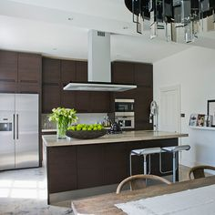 Kitchens: Modern Kitchen with Wood Look Cabinet also Wooden Island plus Stainless Steel Refrigerator and Over Island Range Hood