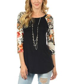 A captivating floral contrast livens up the look of this breezy tunic. Stretch-enhanced fabric make for a flattering fit.  Necklace not included Size S: 32'' long from high point of shoulder to hem 95% rayon / 5% spandex Hand wash; hang dry Made in the USA