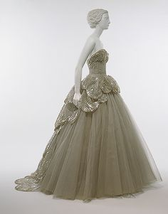 """Venus"" dress, 1949  Christian Dior (French, 1905–1957)  Gray silk net embroidered with feather–shaped opalescent sequins, rhinestones, simulated pearls, and paillettes - http://www.metmuseum.org/toah/works-of-art/C.I.53.40.7a-e  - see detail below"