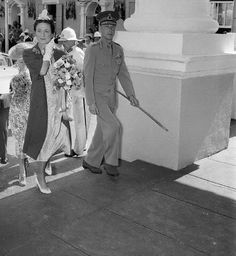 The Duke and Duchess of Windsor walk up the stairway of Government House where…