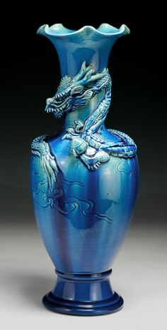 A Chinese Antique Blue Glazed Porcelain Vase: well potted with a dragon encircling around the neck, of Qing Dynasty; of Qing Dynasty; Porcelain Ceramics, Ceramic Art, Fine Porcelain, Porcelain Jewelry, Ceramic Bowls, Perfumes Vintage, Dragons, Vases, Keramik Vase