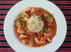 A slow cooked version of authentic shrimp creole made with the holy trinity (celery, onion, bell pepper), tomatoes and tomato sauce, garlic, Tabasco, and shrimp all served over hot rice.