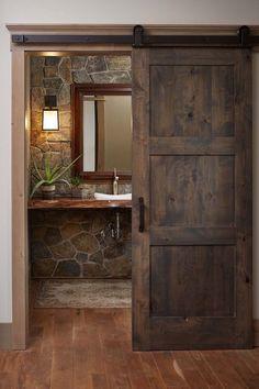 Love the rock wall and sliding barn door
