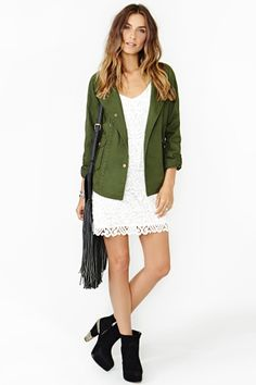 'Truce' army jacket over a white boho chic lace dress. Black stacked ankle boots and fringed leather cross body add some serious rock chic appeal.