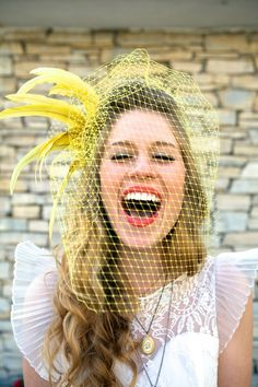 love this yellow birdcage veil and her darling cap sleeves! She looks perfect :)