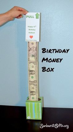 """Easy Peasy Birthday Money Box: The birthday money box is fun to give and receive because when the gift recipient pulls on the card that says """"PULL UP,"""" they will be surprised with a really long strand of cash that continues to come out as they keep pulling and pulling and pulling! It's so easy to make. All you need is a tissue box, cash, tape and paper."""