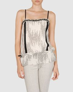 Good basic. Organic silk top from Edun… the company co-founded by Bono's wife, Ali Hewson.