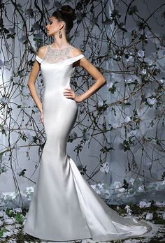 Victor Harper. Off the shoulder fitted gown in satin. Embroidered halter yoke, with beaded back and train.