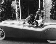 Humphrey Bogart, Lauren Bacall and son Stephen in his Jaguar XK 120