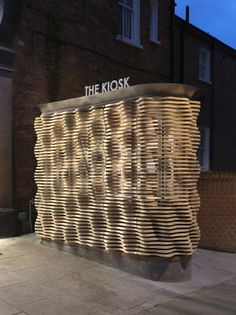 Microscopic views of flower petals informed the rippled timber facade of this flower kiosk in west London by British firm Buchanan Partnership (+ slideshow). Kiosk Design, Booth Design, Retail Design, Store Design, Signage Design, Design Design, Graphic Design, Corporate Design, Architecture Design