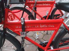 red bike with text swisshotel amsterdam