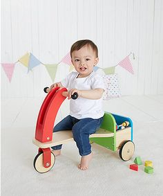 This traditional wooden trike with storage at the back is perfect for zooming around, carrying toys and exploring.