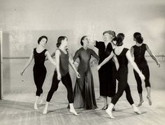 Helen Keller surrounded by a group of young dancers at Martha Graham's studio circa 1954