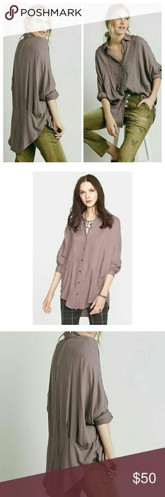"""NWT FREE PEOPLE TRUE AFFECTION HERRINGBONE SHIRT Slouchy dolman sleeves and a draped shirttail hem accentuate the stylishly oversized fit of a paneled button-front shirt textured in a subtle herringbone motif. 30"""" Length. Spread collar. Two button  barrel cuffs. Semi-sheer.100% rayon. Smoke  Purple  color Free People Tops Button Down Shirts"""