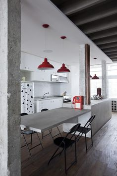 Industrial chic kitchen with red accents, more ideas at http://www.myhomerocks.com/2012/05/industrial-style-kitchens/ #homedecor