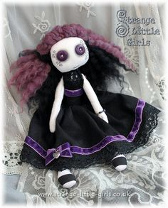 OOAK Gothic style cloth art doll 'Victoria Velveteen' has purple buttons for eyes. Her facial features have been hand drawn in coloured pencil and ink. #Gothic #Doll #ArtDollsOnly
