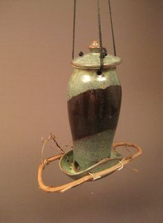 Pottery Bird Feeder. $38.00, via Etsy. Look at how the lid is fastened on.