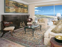 A Rare Antique Mohtasham Kashan Rug Creates the Perfect Ambiance for This Asian-themed Sitting Room