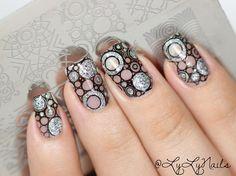 Holo nail art stamping over black nail polish using Delush Polish's Dazed & Enthused stamping plate.