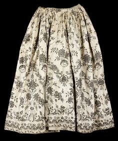 "petticoat ca. 1570-1575 via The Victoria & Albert Museum    ""Although it is hand-drawn, the simple treatment of the design on this skirt almost gives the appearance of a block-print. Unusually for a chintz fabric, the black has been drawn directly onto the cloth. There is an East India Company stamp on top of the painted design on one side of the petticoat. Black designs like this were probably intended as mourning wear."""