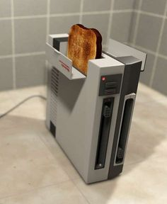NES Toaster - Many people talk about cooking as though it's a fun and enjoyable activity, but I think this NES Toaster is the closest anyone will ever get ...