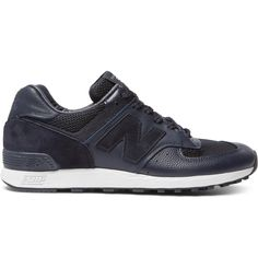 Mr William Riley founded <a href='http://www.mrporter.com/Shop/Designers/New_Balance'>New Balance</a> as the 'Arch Support Company' in 1906, and comfort has been integral to every design since. These navy '576' sneakers have been handmade in England from panels of smooth leather and breathable mesh. They have a cushiony lining and are set on dependable rubber soles. Wear them when you need to negotiate your way through a busy airport terminal or simply for running errands.