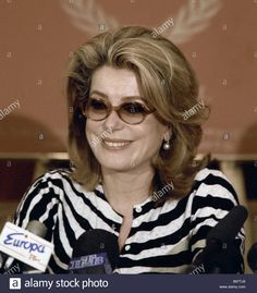 Download this stock image: Catherine Deneuve a French movie star who played a supporting role in Regis Varnier s movie Est Ouest at a news conference - B97TJ6 from Alamy's library of millions of high resolution stock photos, illustrations and vectors.