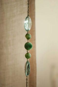 Detalle en verde y cristal para las cortinas