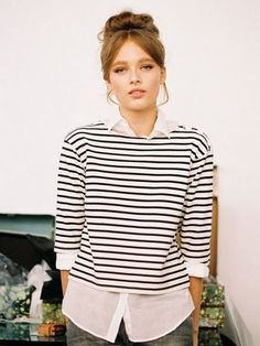 Not only do I love this striped shirt, but the whole Audrey Hepburn thing she has going on...