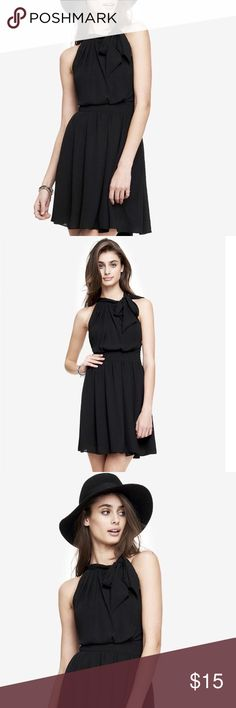 Tie Neck Halter Dress Light crepe fabric, soft pleating and a flaring skirt give this halter dress lovely, rippling movement. The bow detail at the neck adds a classically chic touch. Worn once. Express Dresses Mini