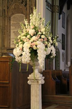 At the head of the aisle two of the most dramatic church pedestal designs stood like two guardian angels looking over the proceedings
