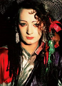 I had a boy George and the culture club book when I was a girl. It belonged to my sister, Andrea, but I would look through it all the time admiring his style. Boy George, People Around The World, We The People, Victorian Gown, Village People, Lgbt Rights, Culture Club, We Are The World, Celebs