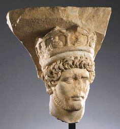 Roman, Early Antonine  Head of a priest of the Imperial cult, possibly from a votive pillar, ca. 125 – 150 A.D.  Bluish marble