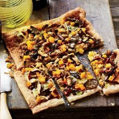 Mushroom, Butternut Squash & Gruyère Tart | Food & Wine bake puff pastry then top with 2- yolks, creme fraiche, gruyere and veg and rebake