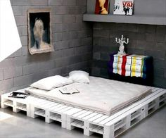 DIY pallet white platform bed, haha this is funny my fiancé had a pallet bed because he didn't want to buy a bed frame:)