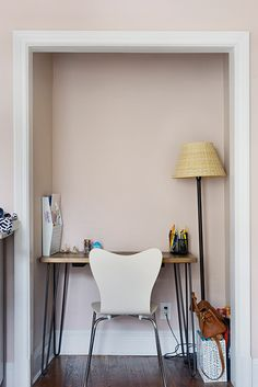 Hari and Kaity removed the old bedroom closet's sliding door, painted the walls with a light shade of pink (Benjamin Moore in Gobi Desert), and created a cozy office retreat.