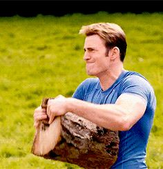 Chris Evans as Steve Rogers/Captain America tearing apart a log with his bare hands! Avengers: Age of Ultron